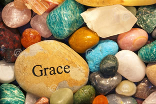 "stone with ""grace"" written upon it"