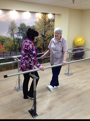 Tanya Gensler and Pat Shoemaker take advantage of Evenglow Lodge's therapy room renovation.